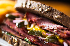 Pastrami. Detail of pastrami sandwich with french fries ready to eat Royalty Free Stock Photo