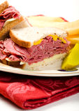 Pastrami  on Rye. Pastrami sandwich with thick french fries and pickle Royalty Free Stock Photography