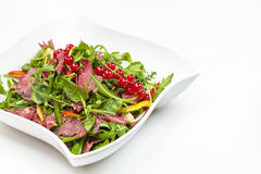 Pastrami Salad. In a white bowl shot on a white background Royalty Free Stock Images
