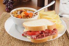 Pastrami sandwich with soup. A pastrami sandwich with vegetable soup and chips Stock Photo