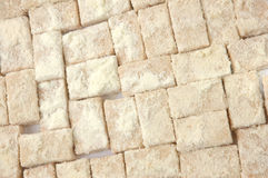 Pastries. Pattern of sweet pastries sprinkled with powdered milk Royalty Free Stock Images
