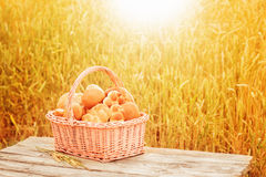 pastries in a basket on a wooden table Royalty Free Stock Photography