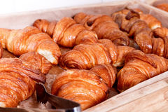 Pastries and bread in a bakery. Sweet Croissants with chocolate and jam Stock Images