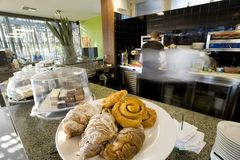 Pastries at a cafe. With cooks in the kitchen Royalty Free Stock Image