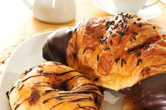 Pastries and coffee Stock Images
