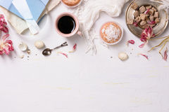 Pastries and coffee, white background. High angle view, copy space. royalty free stock images