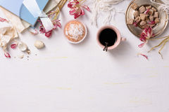 Pastries and coffee, white background. High angle view, copy space. stock image