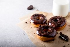 Pastries concept. Donuts with chocolate glaze and chocolate cookies.  royalty free stock photo