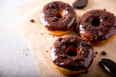 Pastries concept. Donuts with chocolate glaze and chocolate cookies. / royalty free stock images