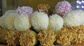 pastries covered with coconut flakes and peanuts for sale Royalty Free Stock Images