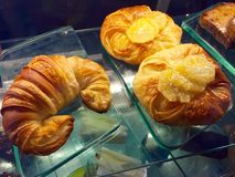 Pastries - Croissant or. Croissant is is a buttery, flaky, viennoiserie or Vienna-style pastry named for its well-known crescent shape. Croissants and other Stock Photo