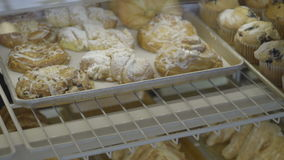 Pastries and croissants are put into case stock video