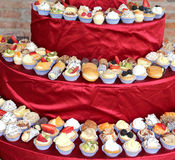 Pastries with custard and fruit during the wedding lunch at the Royalty Free Stock Photos