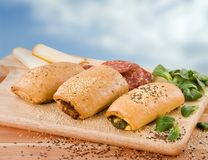 Pastries filled with spinach, salami and cheese Stock Photos