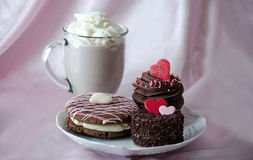 Pastries and mug of chocolate  mocha frappuccino with whipped cream Stock Images
