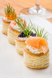 Pastries with salmon, caviar and prawns Royalty Free Stock Image