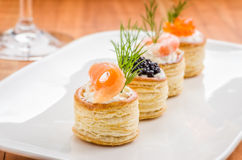 Pastries with salmon, caviar and shrimps Royalty Free Stock Images