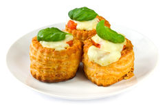 Pastries with tomato and cheese Stock Photography