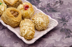 Pastries. Typical Oriental Pastries with honey and nuts Royalty Free Stock Images