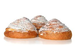 Pastry. Three mountains. Pastry coverd with white glaze Stock Photography