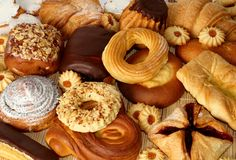 Pastry. There are many types of pastry with different ingredients on the table Stock Photos