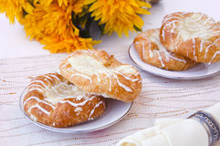 Pastry. Tasty pastry and yellow flowers Stock Images