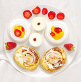 Pastry. Plate of delicious mixed baked goods pastries Stock Photography
