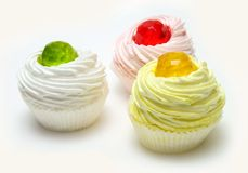Pastry. Three cream puffs with colored jelly Royalty Free Stock Photo