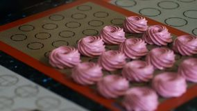 From pastry bag squeezed to pink marshmallow mass. stock video footage