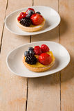 Pastry with berries on wooden table Royalty Free Stock Photo