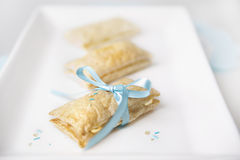 Pastry bond by a baby-blue ribbon. Royalty Free Stock Images
