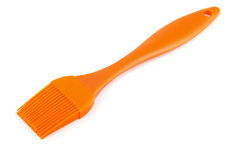 Pastry brush. Orange silicone pastry brush  on white Stock Image