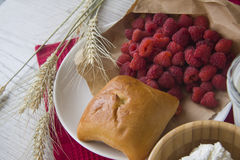 Pastry buns with raspberries Stock Photography