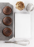 Pastry cakes : chocolate muffins with cream. Space for text Royalty Free Stock Images