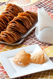 Pastry cakes with nuts on plate. Stock Images