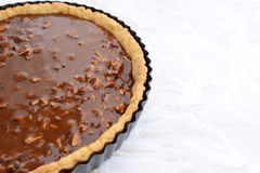 Pastry case filled with nutty pecan pie filling Stock Photo