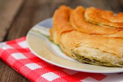 Pastry with cheese and spinach and red dish towel royalty free stock photo