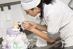 Pastry chef decorates a cake Royalty Free Stock Image