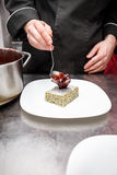 Pastry chef decorating a cake Stock Image
