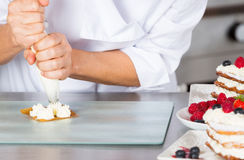 Pastry chef decorating Royalty Free Stock Image