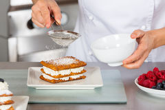 Pastry chef decorating Royalty Free Stock Photos