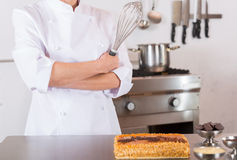 Pastry chef decorating Stock Image