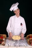 Pastry Chef Dinner Rolls. Assertive posed uniformed female Pastry Chef holding an 8 in pan of dinner rolls ready for the oven Royalty Free Stock Images