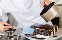 Pastry chef in the kitchen Stock Photo