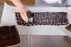 Pastry chef in the kitchen Stock Photography