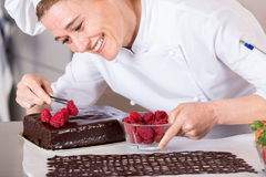 Pastry chef in the kitchen Stock Images