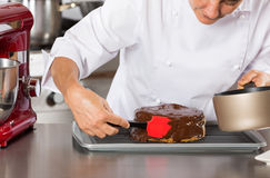 Pastry chef in the kitchen Royalty Free Stock Images