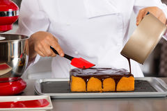 Pastry chef in the kitchen Stock Image