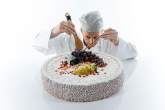Pastry chef in a large cake Stock Photo