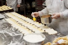Pastry chef is making buns royalty free stock images